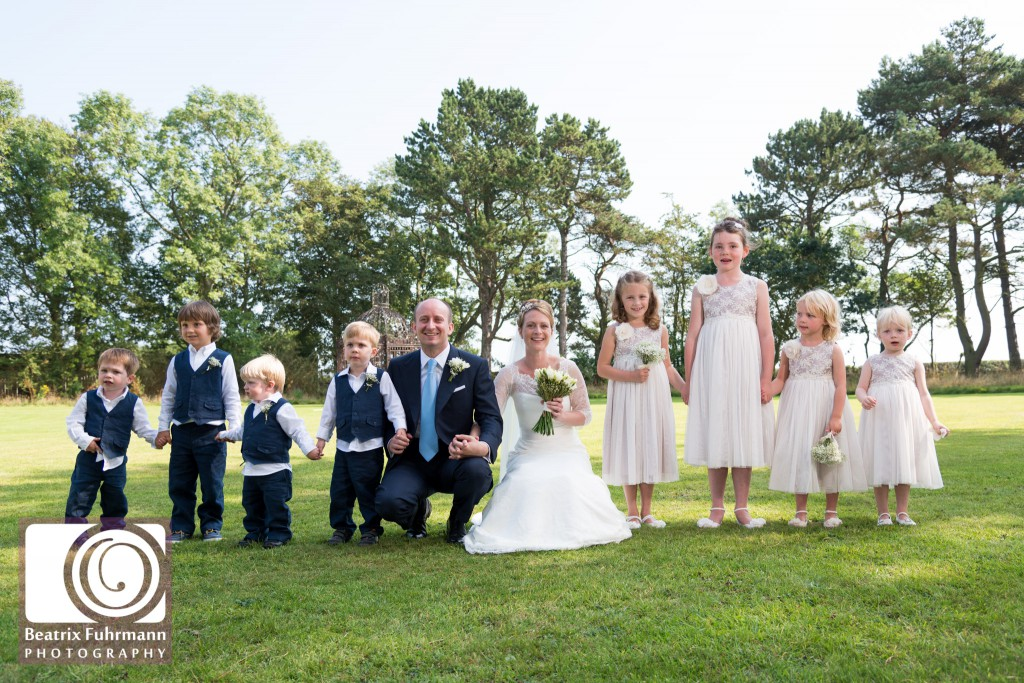 Bride and groom with flowergirls and page boys