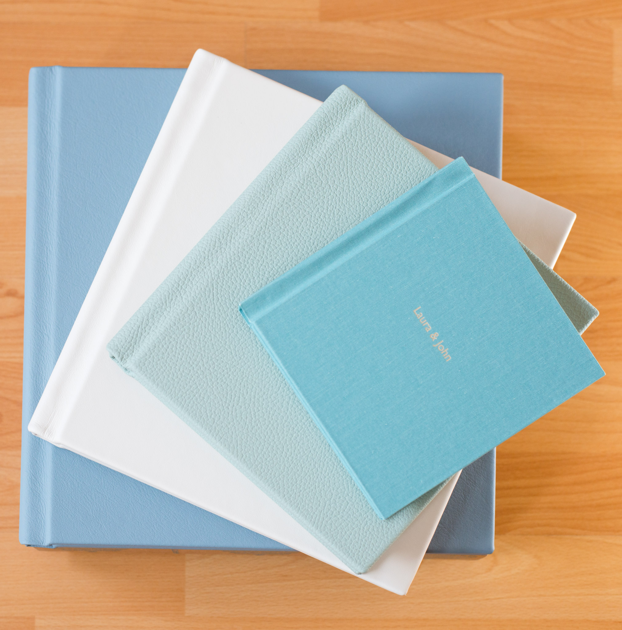 4 fine art print albums in different sizes ranging from 6 x 6 to 12 x 12