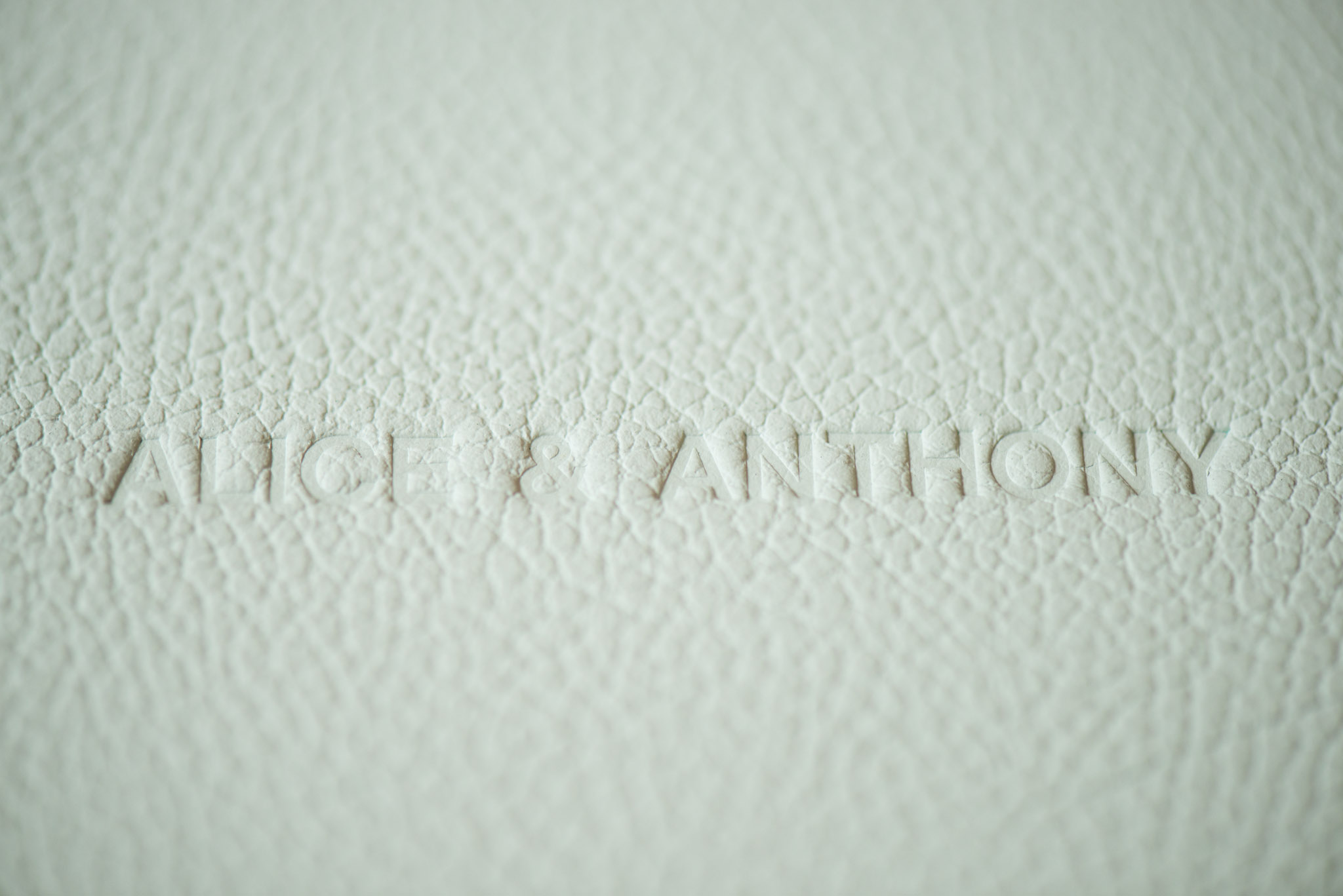 Ebossed names on fine art leather album