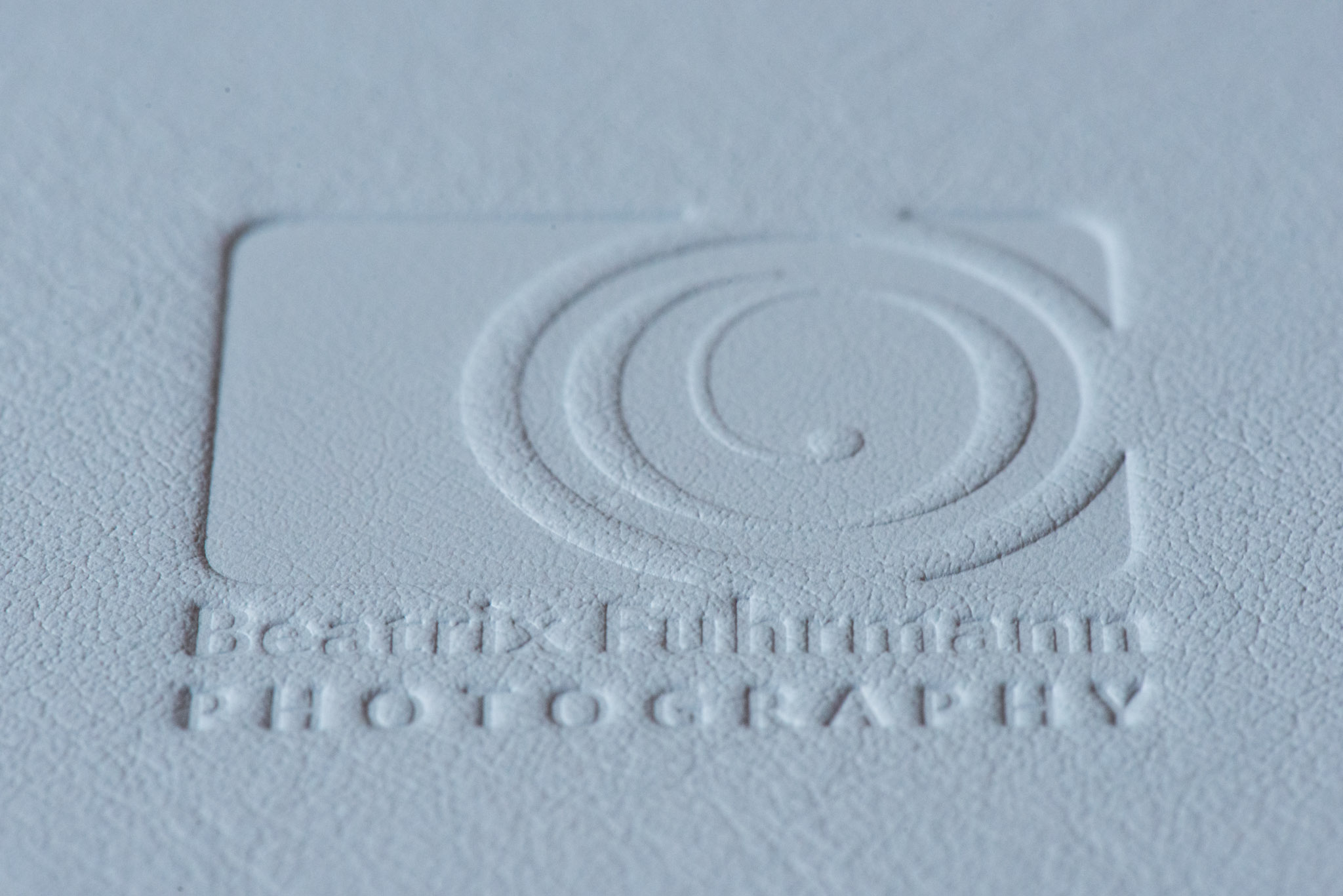 Embossed studio logo