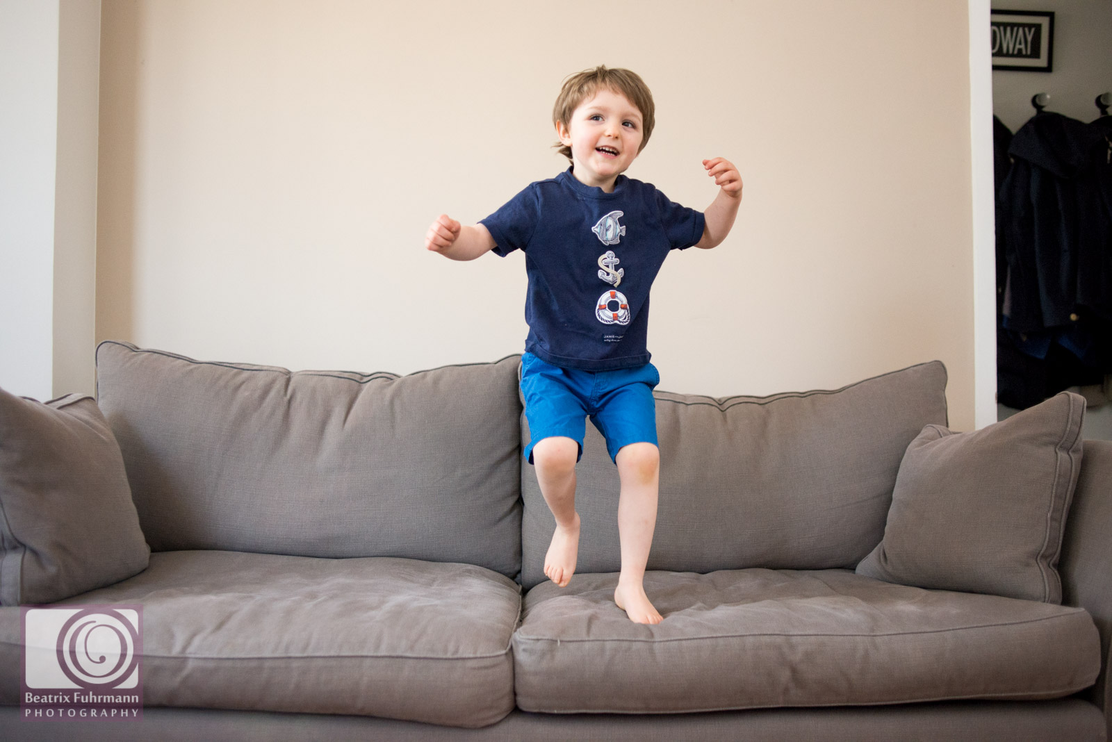 litte boy jumping on the sofa