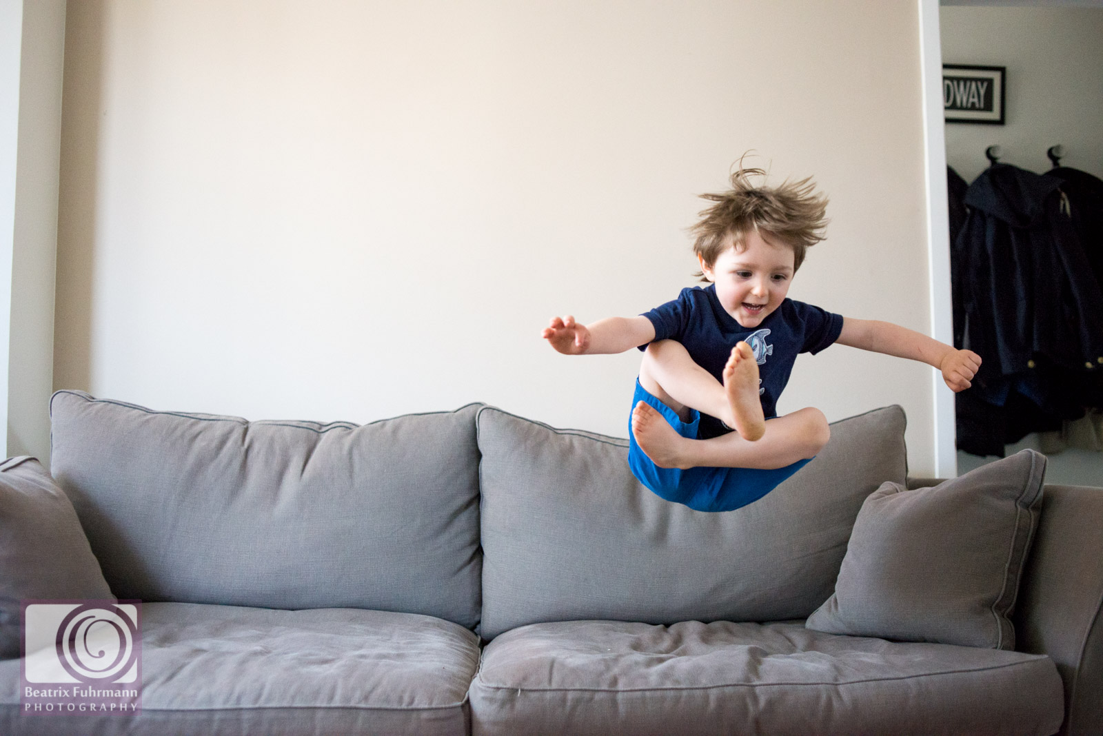 Little boy jumping on the sofa