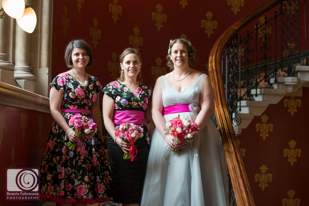 bride and her bridesmaids in fifties style tea lenth dresses
