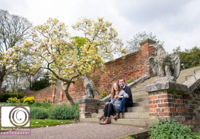 Couple sitting on the steps at Walterlow Park for a North London Wedding Photography sessionwith Magnolia tree in the background