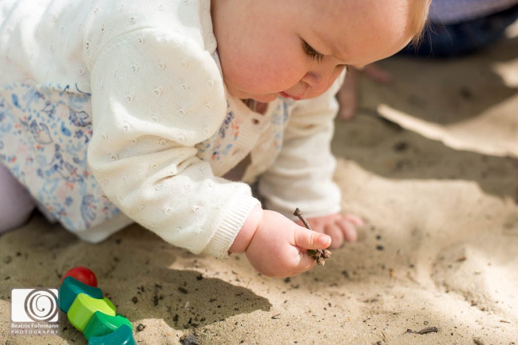 baby hands playing with sand - baby photography north london