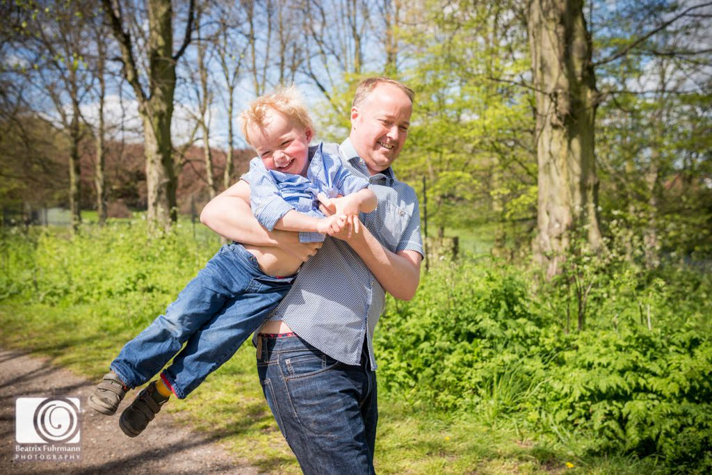 Father carrying his son laughing - Family photography north london
