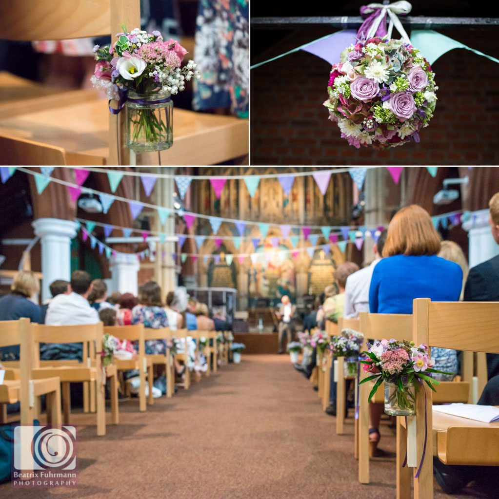 Wedding flowers and bunting in shades of purple and green