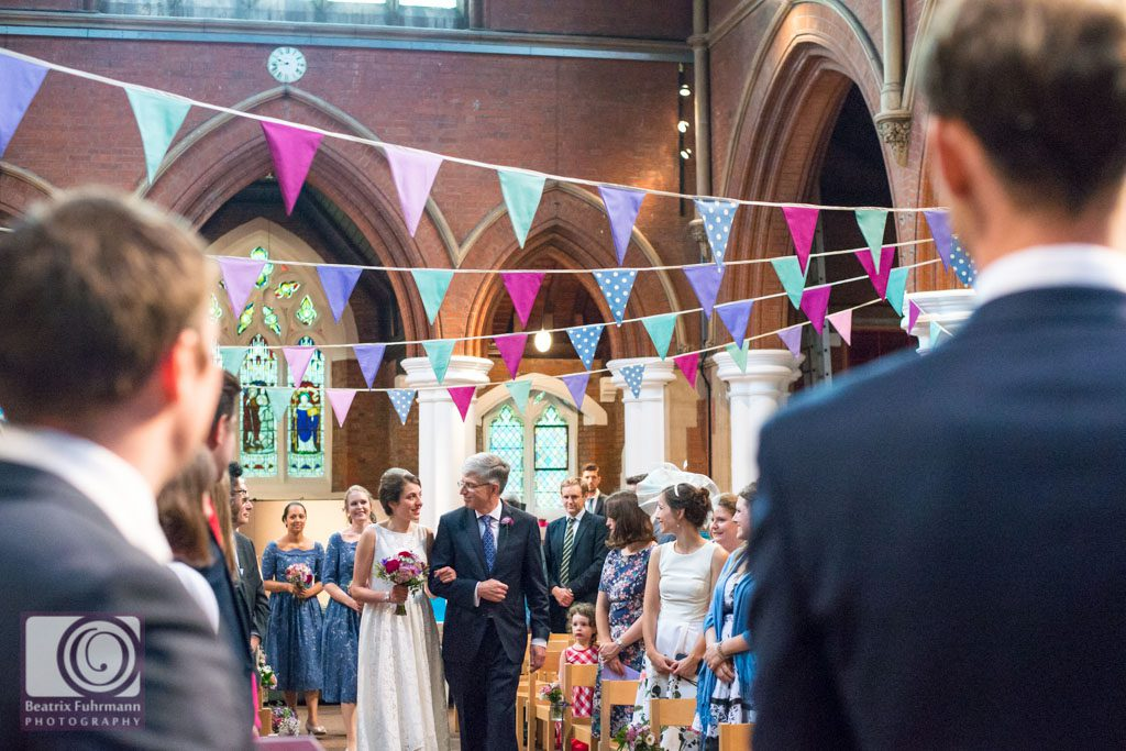 Gorgeous Crouch End wedding - Bride and father walking down the isle at St. Saviours Christchurch