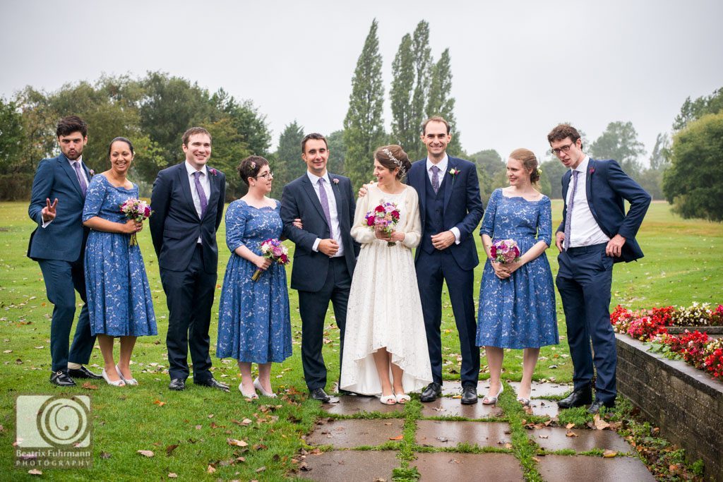 Bridesmaids and groomsmen portrait with bride and groom at the Muswell Hill Golf Course