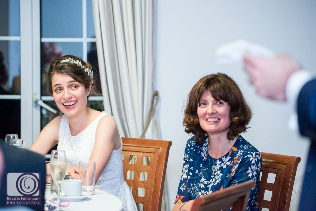 Bride and her mum reacting to Groom's speech