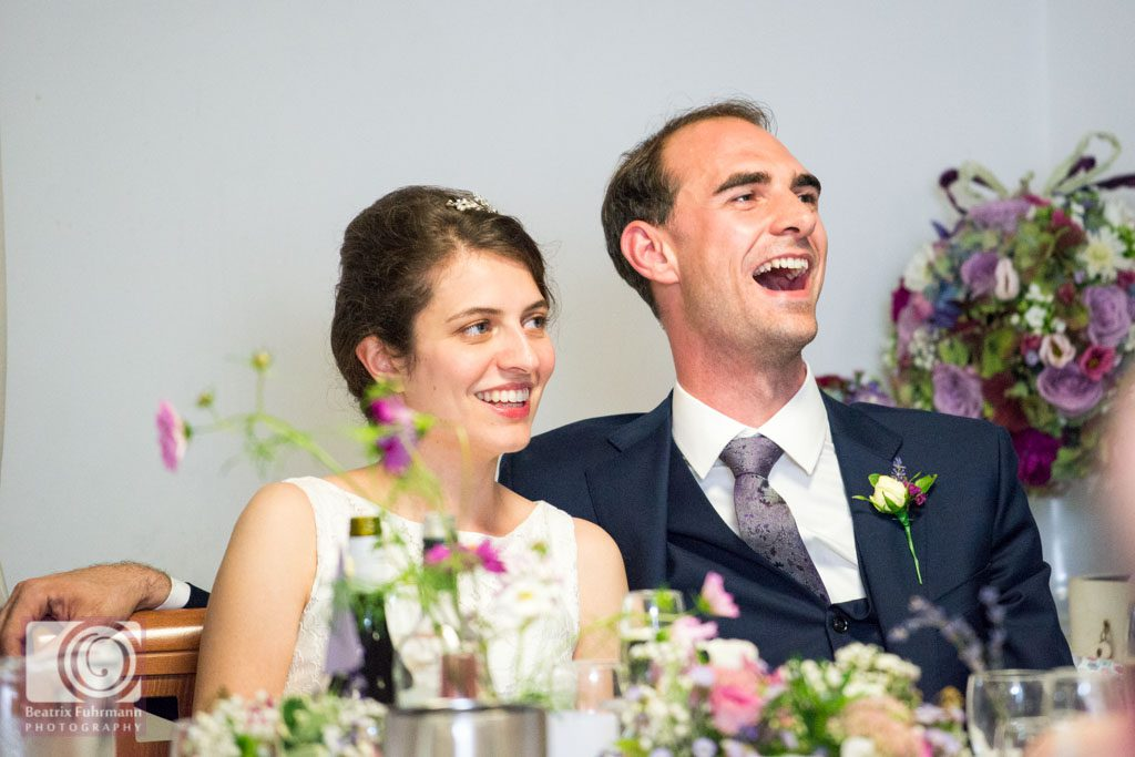 Groom in broad laughter during the best man's speech