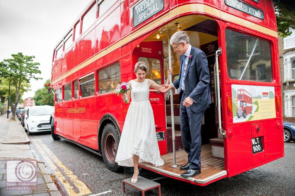 Bride and father arriving with Routemaster at the church