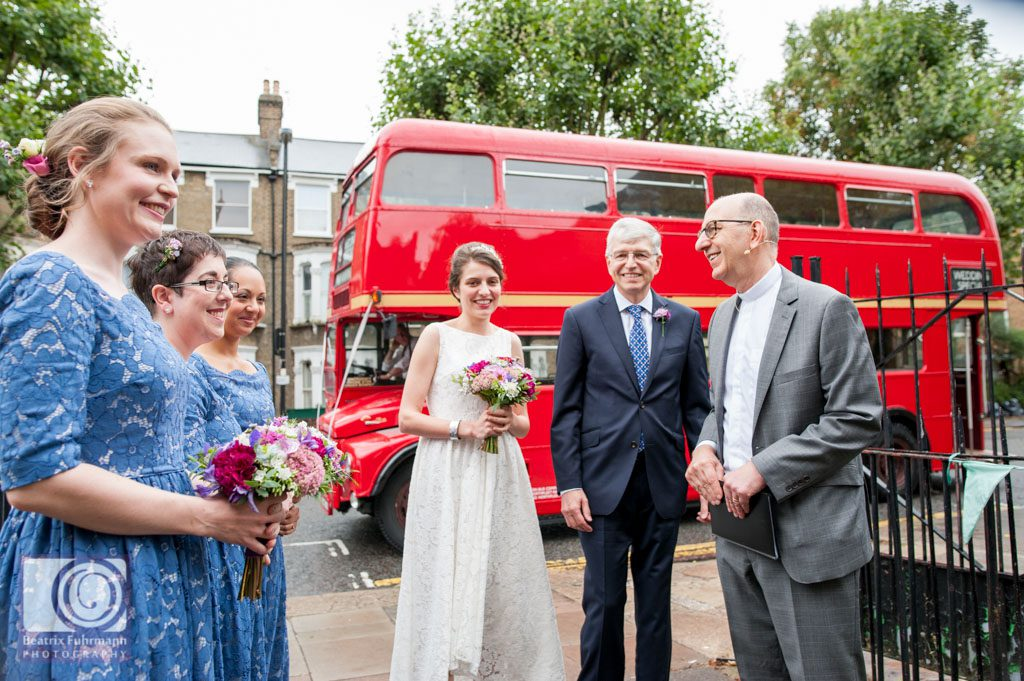 Bridal party arriving at the church with a Routemaster