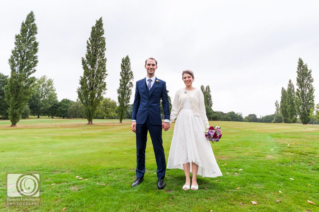 Bride and groom posing on the Muswell Hill Golf course