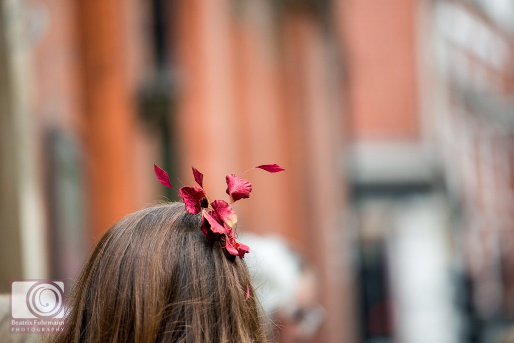 Autumnal fascinator with red leaves