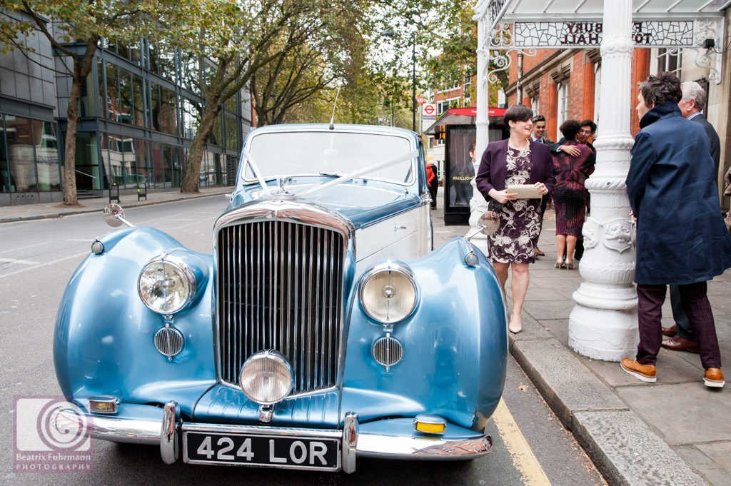 Blue Vintage Bentley arriving at The Old Finsbury Town Hall with the brides
