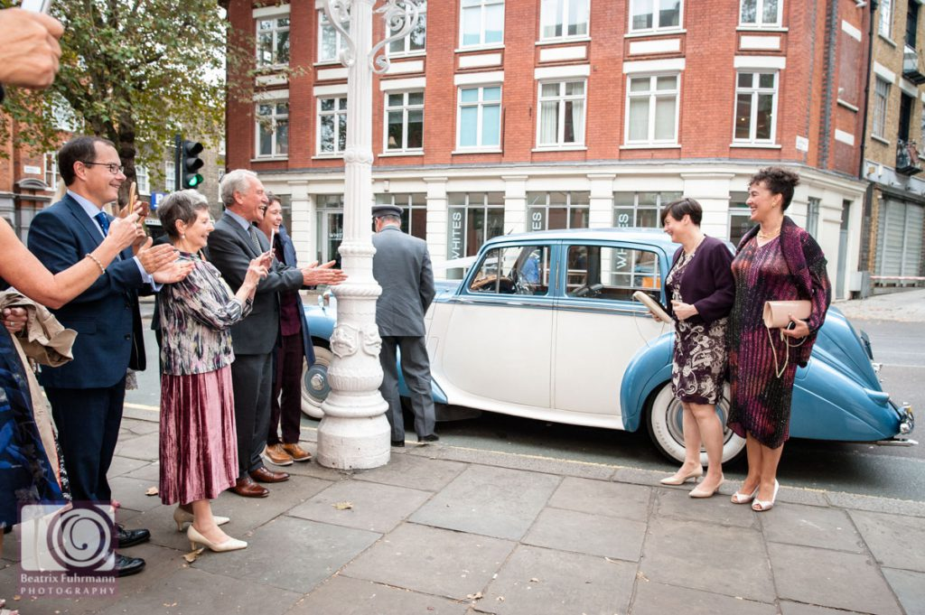 Brides exiting the car - Old Finsbury Town Hall Wedding photography