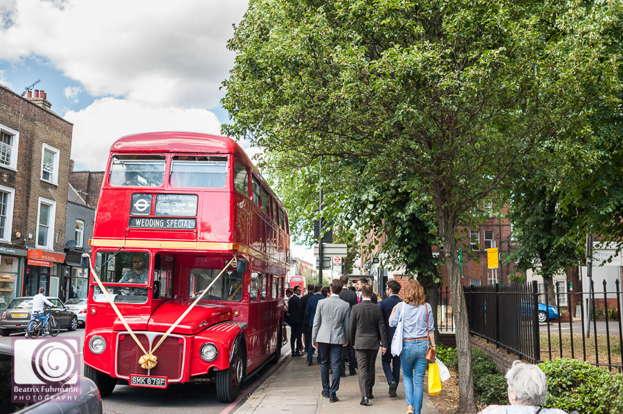 A Routemaster bus is picking up wedding guests for a tour of London