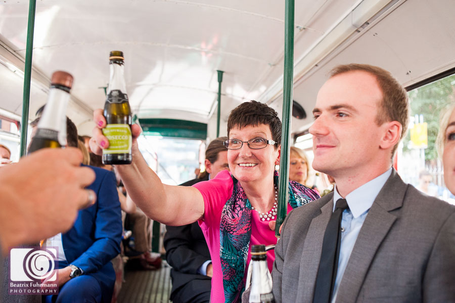 Wedding guests on the Routemaster with belgian drinks