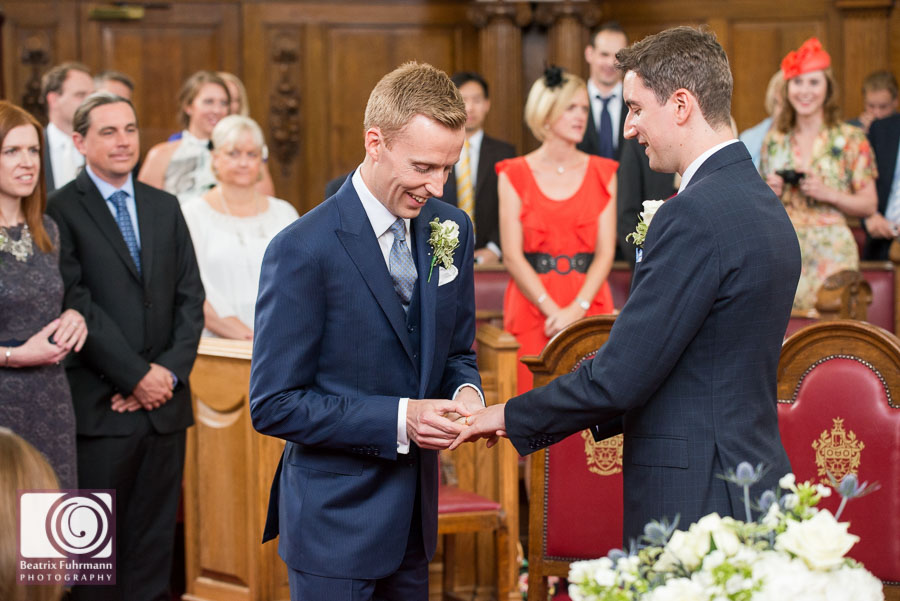 Grooms exchanging rings at the Islington Town Hall - Gay London wedding photography