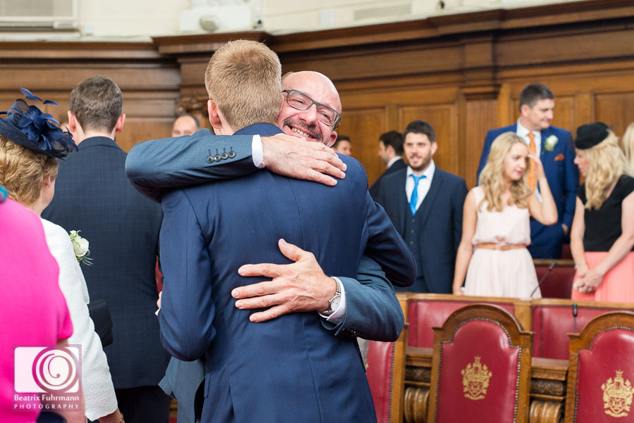 Father of the groom hugging his new son in law