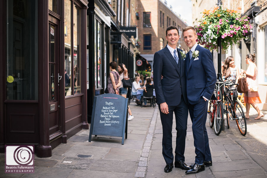 The grooms at their beloved Camden Passage, home of their reception