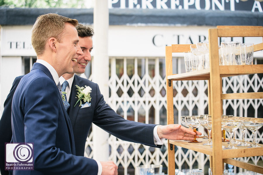 Grooms looking at second hand glassware, a hobby of both