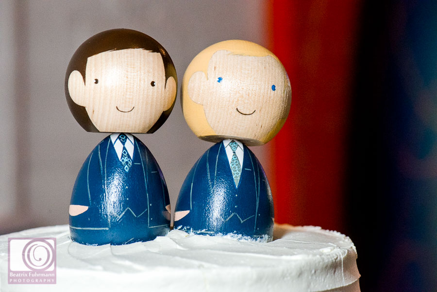 Cute wooden peg doll grooms as cake topper - Gay London wedding