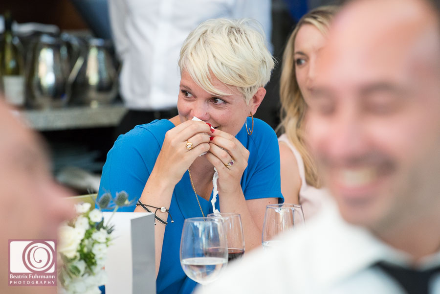 Wedding guest sniffling during the heartfelt groom's speeches