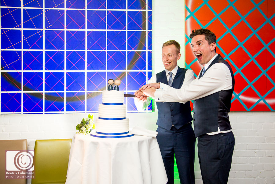 Grooms cutting the wedding cake - Gay London Wedding Photography