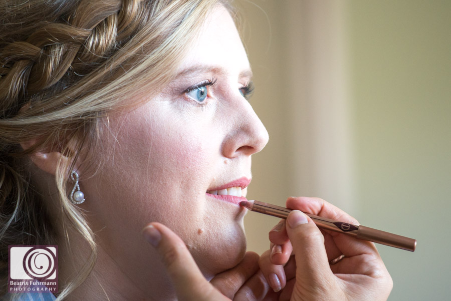Bride in makeup, finishing touches on the lips
