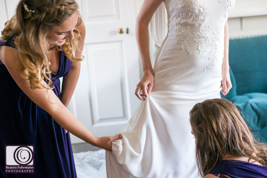 Adjusting the low hem of the bride's fit and flare wedding dress