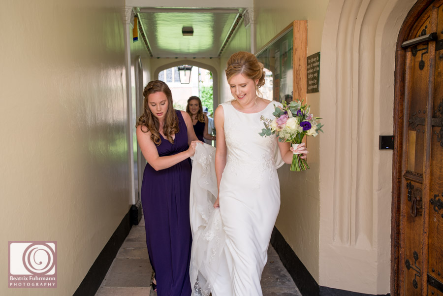 Bride and bridesmaids walking to the chapel