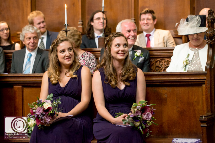Bridesmaids smiling during the wedding ceremony