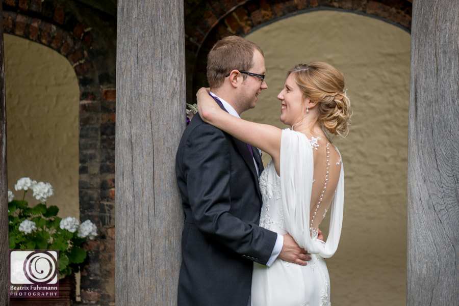 Wedding portrait at Queens College showing off the wedding dress' gorgeous illusion back with lace applique