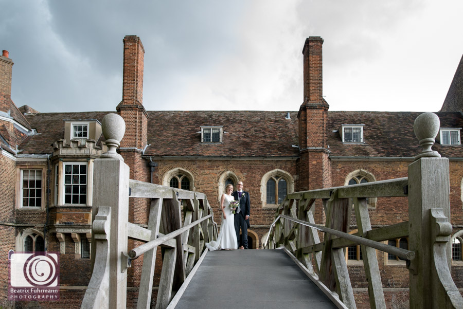 Bride and Groom on the Mathematical Bridge, Cambridge with cloudy skies