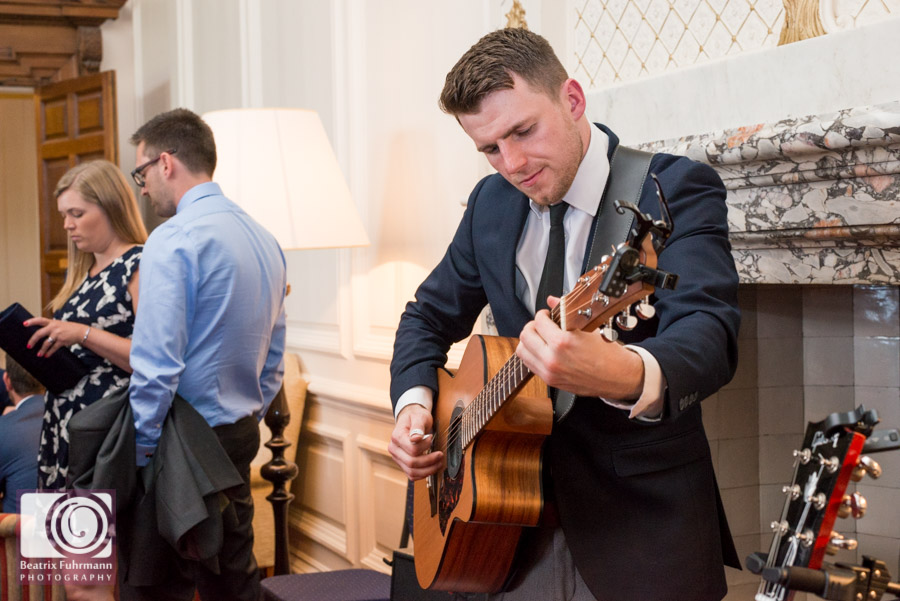Acoustic guitar playing during the Madingley Hall drinks reception