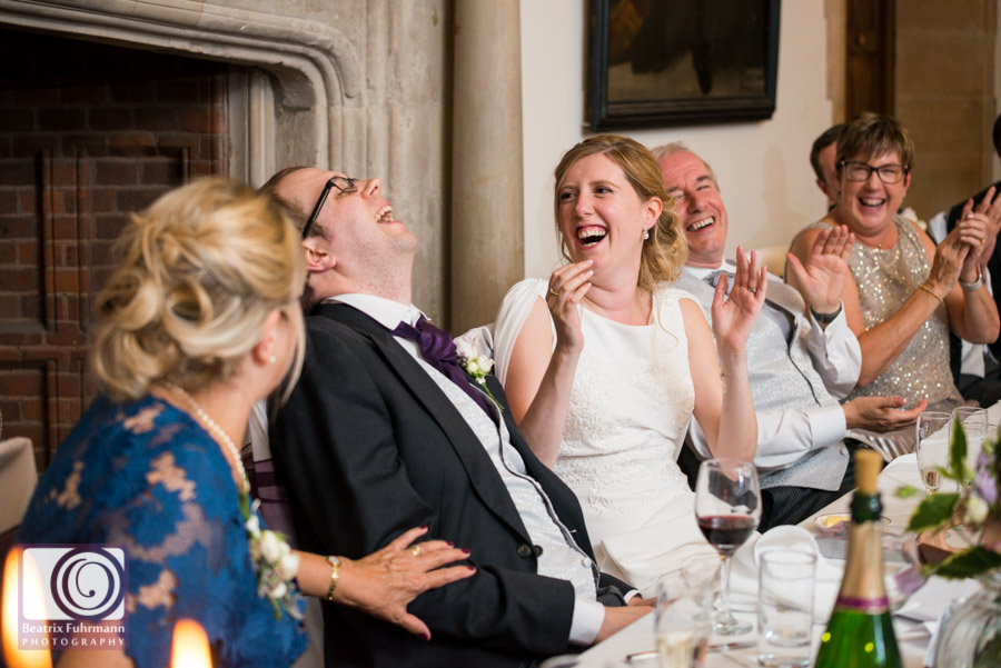 Bridal party laughing during the speeches