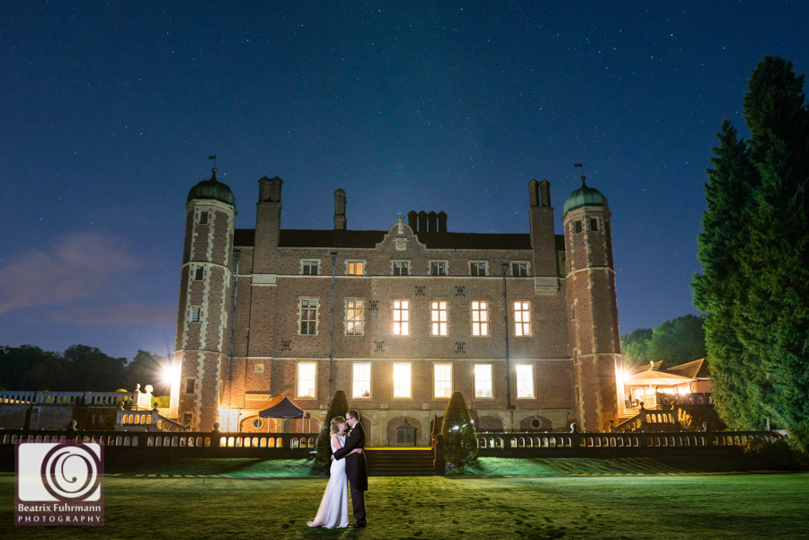 Bride and groom under the starry sky for a Madingley Hall portrait