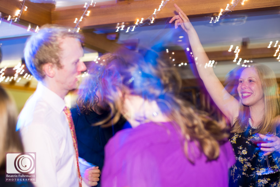 Wedding party dancing under fairy lights