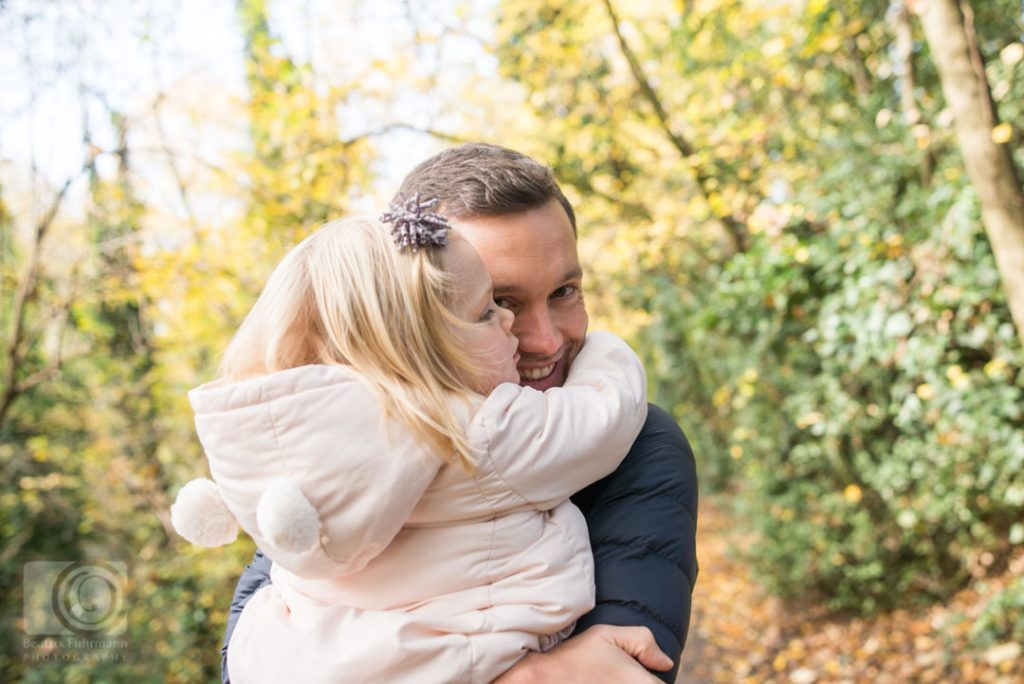 Father carrying his daugther smiling - Crouch End family photography