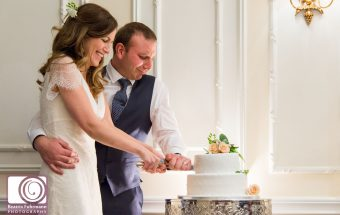 Wedding couple cutting the cake at the Savoy London